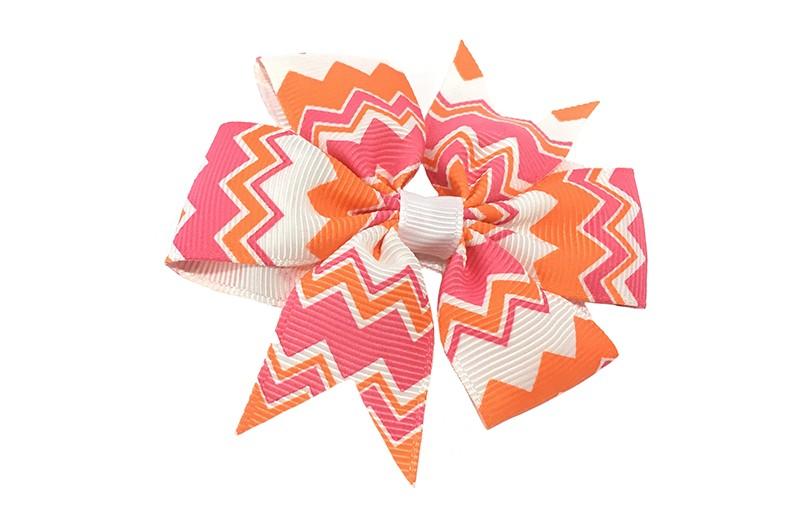 Vrolijke grote haarstrik met roze, oranje en witte zigag strepen.