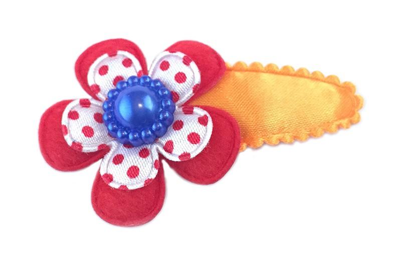 Koningsdag collectie! Leuk fel oranje haarspeldje met een glanzend rood bloemetje en een wit met rood gestippeld bloemetje. Afgewerkt met een mooie blauwe parel.