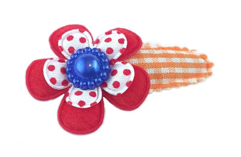 Koningsdag collectie! Leuk oranje wit geruit haarspeldje met effen rode bloem en wit rood gestippeld bloemetje. Afgewerkt met mooie blauwe parel.