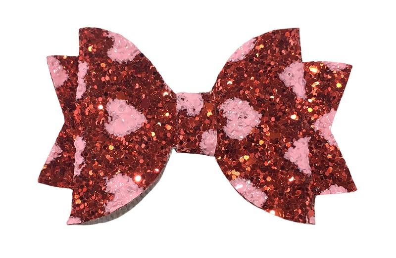 Vrolijke rode glitter haarstrik met licht roze hartjes.  In een mooie dubbellaagse look.  Op een handig alligatorknipje van ongeveer 4.5 centimeter.