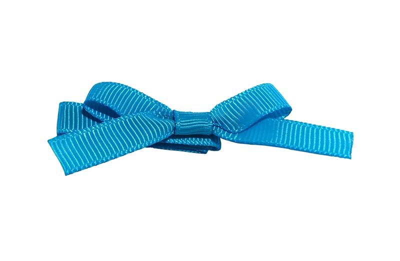 Leuk haarknipje bekleed met fel blauw lint. Met daarop een vrolijk strikje van fel blauw lint. Het knipje is een alligator haarknipje van ongeveer 4 centimeter.