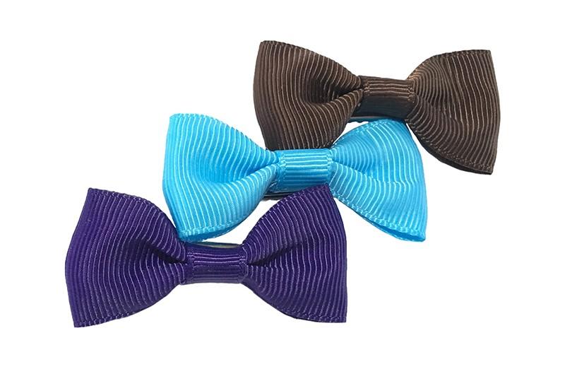 Leuk setje van 3 haarstrikjes in de kleurtjes paars, fel blauw en bruin  Op een handig alligator knipje van ongeveer 3.5 centimeter.