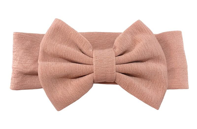 Vrolijke oud roze stoffen baby peuter meisjes haarband. Van rekbare stof met een grote stoffen strik. De strik is ongeveer 12 centimeter breed.